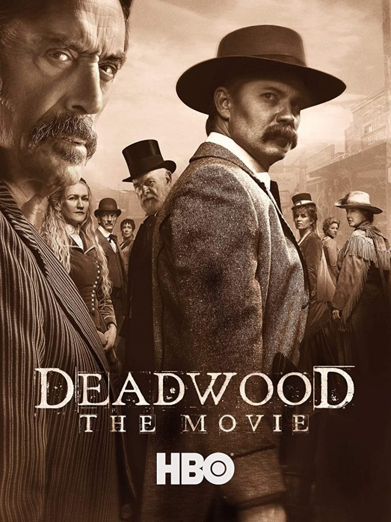 Deadwood movie poster. Actors playng Seth Bullock and Al Swearingen. With crowd behind them.