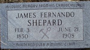"headstone that reads ""In loving memory from his grandchildren. James Fernando Shepard. Feb 3, 1850. June 21, 1908. Murdered over a mining claim."" Adorned with a pick and shovel"