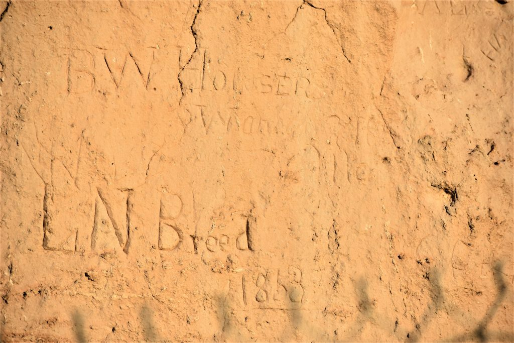 Register Cliff rock face with name carvings. One reads B.W. Howser. The other LN Breed 1868