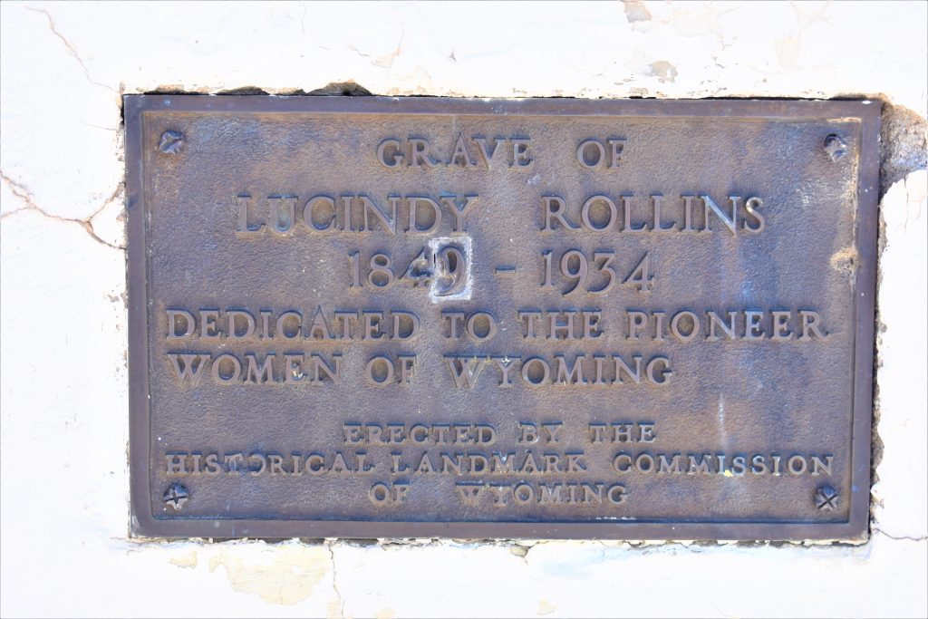 dark plaque on Lucidy Rollins white grave monument