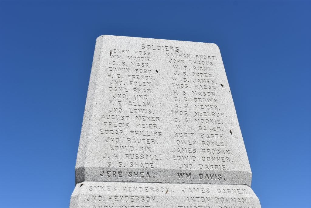 Memorial obelisk with men's names on engraved on the granite stone. This picture bears the names of the Soldiers.