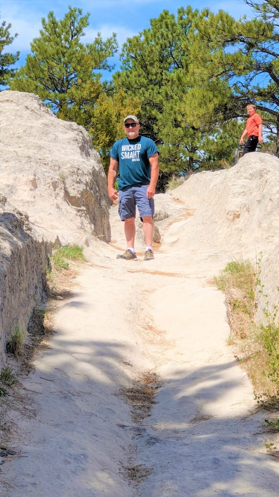 Man standing in the Oregon Trail Rut at Guersney