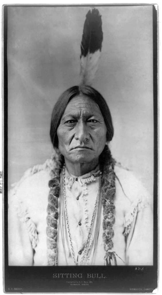 Native American Sioux chief Sitting Bull. With one feather headdress and hair braided.