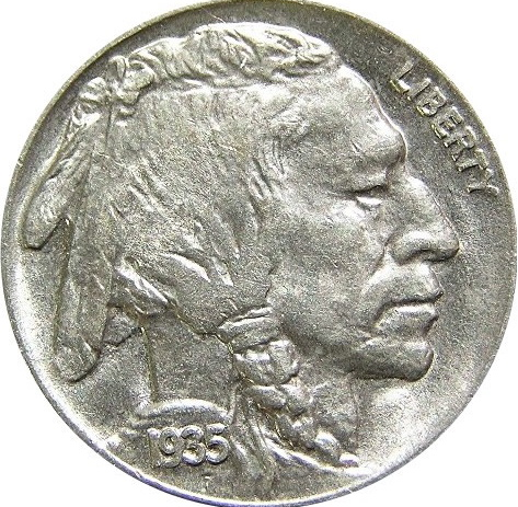 Buffalo Head Nickel with Native America face and 1935 and Liberty engraved.