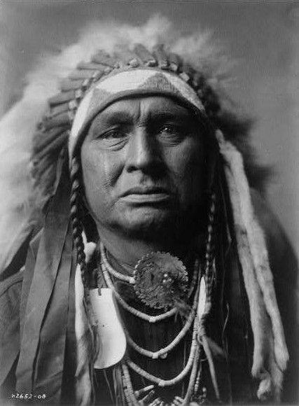 "Native American Crow named ""White Man Runs Him."" In full headdress."
