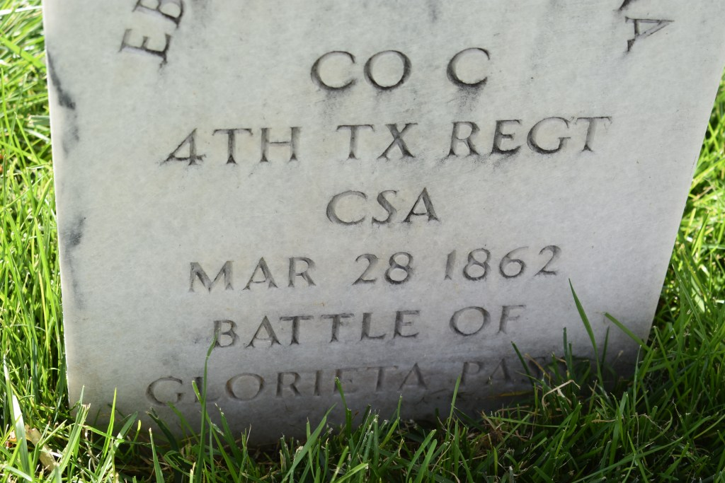 Marble headstone of a Confederate solider. Reads Co C 4th TX Regt CSA Mar 28 1862 Battle of Glorieta Pass