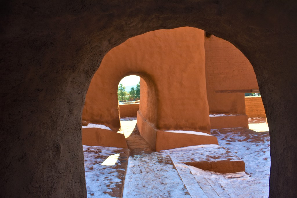 reddish adobe of walls, arch ways, and stairs of the old Spanish Mission built in the 1700s