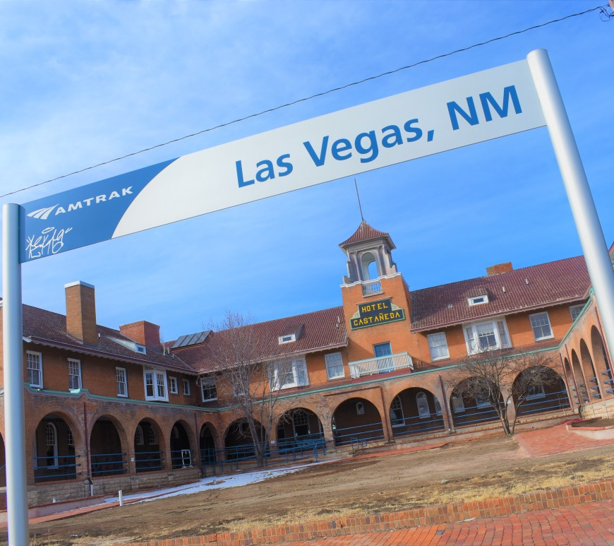 Sign saying Las Vegas, New Mexico. And the hotel in the background