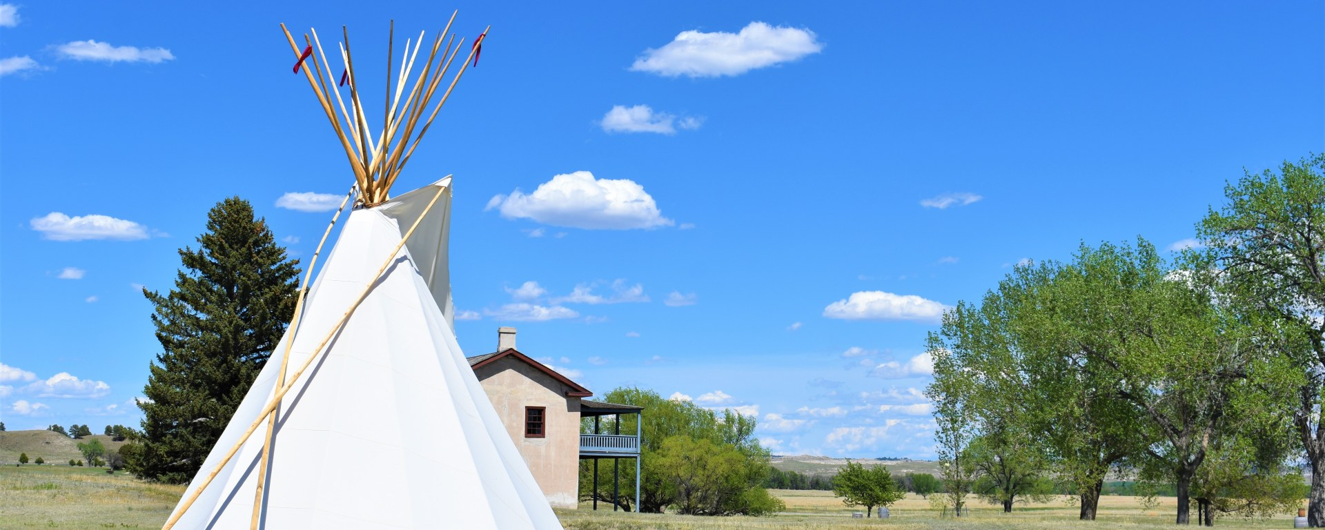 Tipi on the plains of Fort Laramie, Wyoming. Blue sky with few white clouds