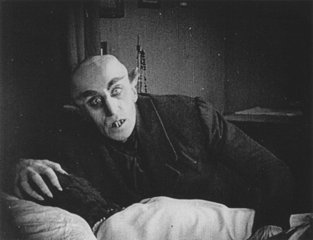 Vampire over a body